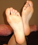 A naked Cali shows off her cute little toes