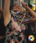 Drunk party girl doesnt notice her tits are still out as she tries to get more beads